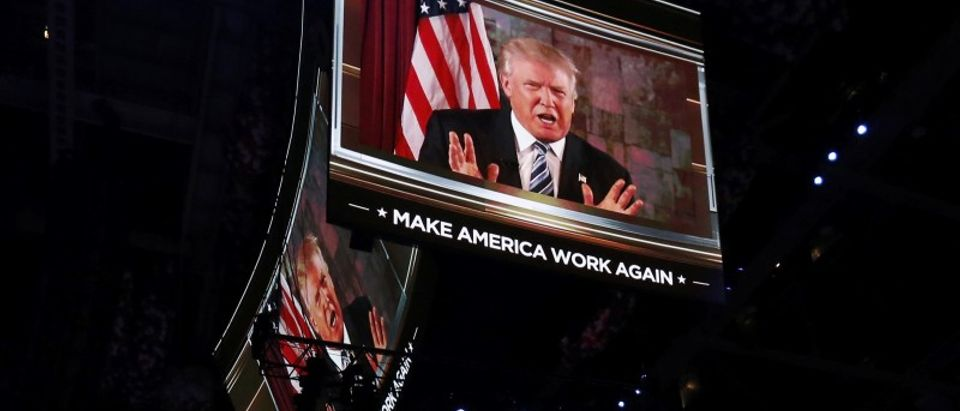 Republican Presidential Nominee Donald Trump is shown on video monitors as he speaks live to the crowd from New York at the Republican National Convention in Cleveland