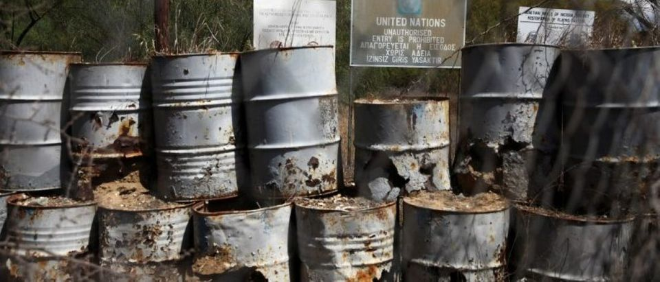 A barricade made of barrels is seen inside the UN-controlled buffer zone in Nicosia