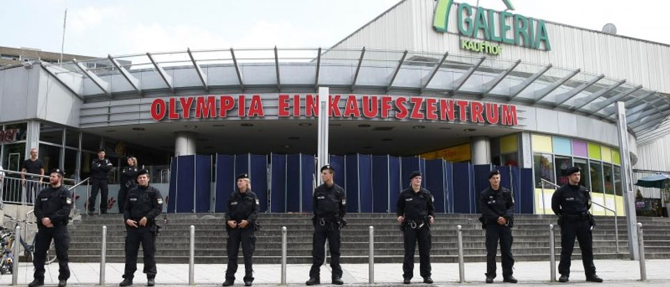 Police stand guard outside Olympia shopping mall in Munich