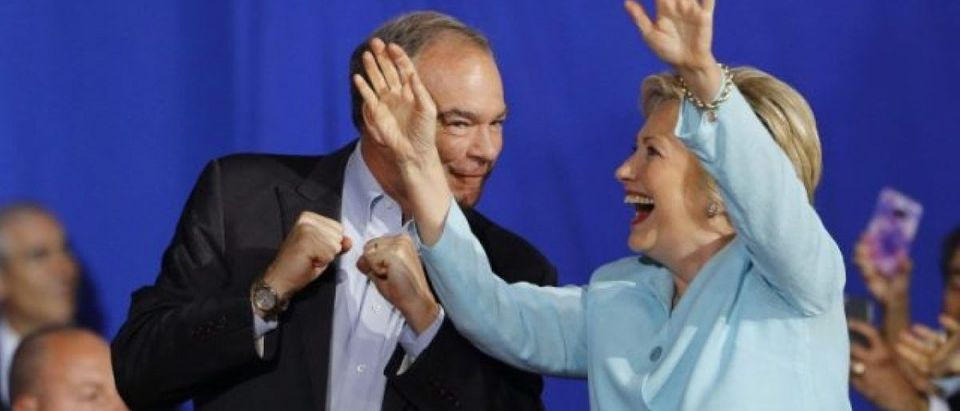 Democratic U.S. vice presidential candidate Senator Tim Kaine (D-VA) and Democratic U.S. presidential candidate Hillary Clinton greet supporters during a campaign rally at which Clinton introduced Kaine as her running mate in Miami, Florida, U.S. July 23, 2016. REUTERS/Scott Audette