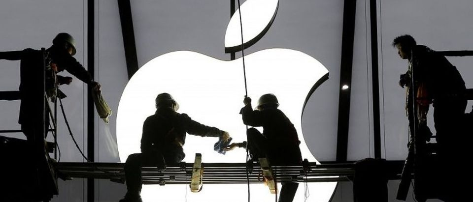 Workers prepare for the opening of an Apple store in Hangzhou