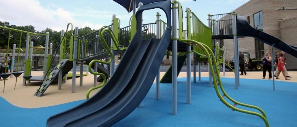 One of the playgrounds of the newly constructed Sandy Hook Elementary School is unveiled by officials in Newtown