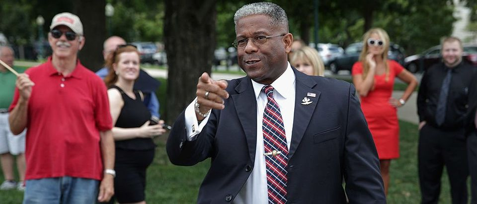 Former Rep. Allen West (R-FL) spots a friend in the crowd before a news conference organized by Special Operations Speaks Out (SOS) Political Action Committee (Getty Images)