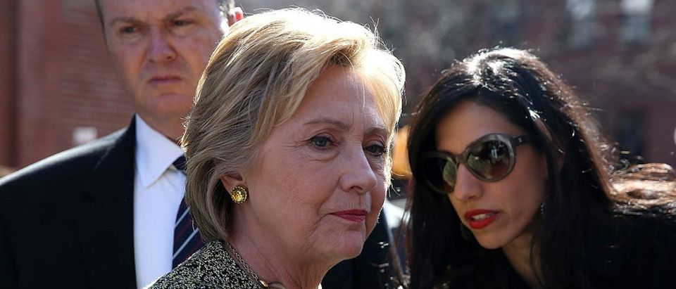 Hillary Clinton talks with aide Huma Abedin before speaking at a neighborhood block party on April 17, 2016 in Brooklyn (Photo: Justin Sullivan/Getty Images)