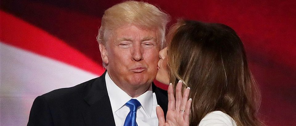 Melania Trump kisses her husband Donald Trump, after delivering a speech on the first day of the Republican National Convention (Getty Images)