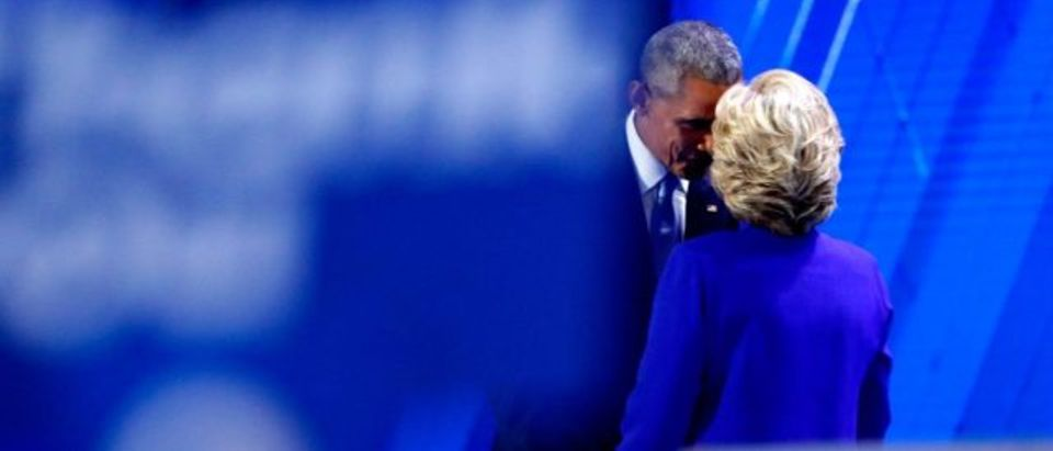 US President Barack Obama and Democratic Presidential nominee Hillary Clinton embrace on the third day of the Democratic National Convention at the Wells Fargo Center, July 27, 2016 in Philadelphia, Pennsylvania. (Aaron P. Bernstein/Getty Images)