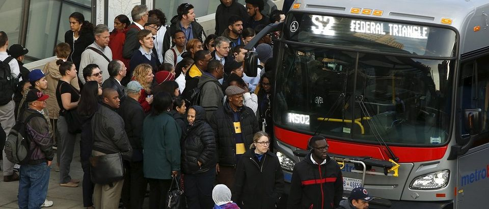 Morning commuters board bus for downtown Washington in Silver Spring, Maryland