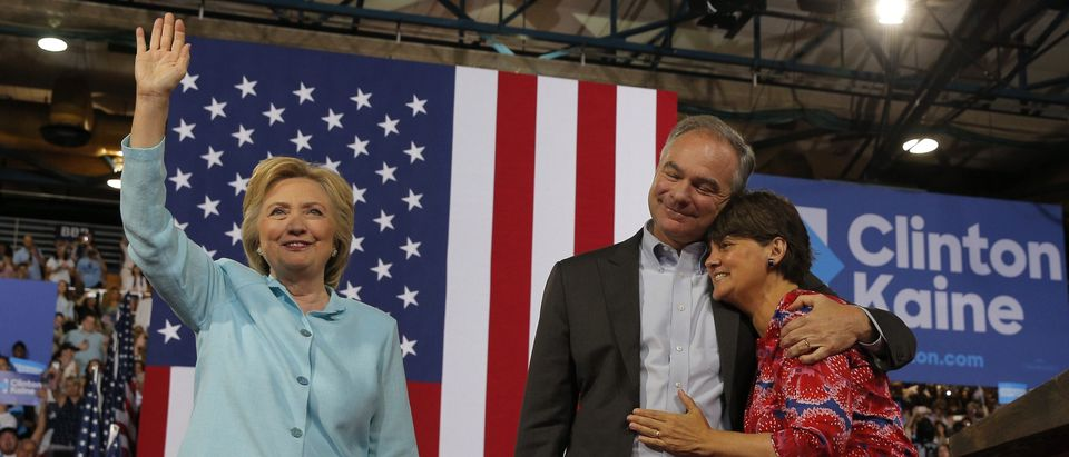 U.S. Senator Tim Kaine is embraced by his wife after his introduction by Democratic U.S. presidential candidate Hillary Clinton as her vice presidential running mate during a campaign rally in Miami