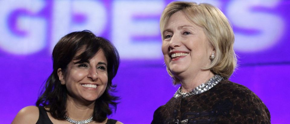 Former Secretary of State Hillary Clinton smiles next to President of the Center for American Progress Neera Tanden at the 10th Anniversary policy forum in Washington