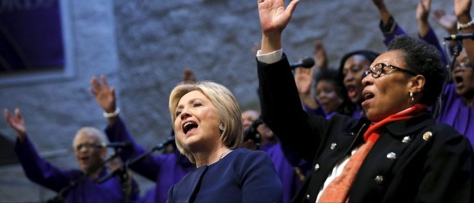 Democratic U.S. Presidential candidate Hillary Clinton attends a mass at the Mt. Zion Fellowship church accompanied by Congresswoman Marcia Fudge during a campaign stop in Highland Hills