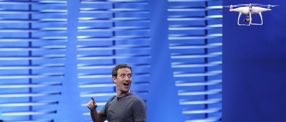 Facebook CEO Mark Zuckerberg looks at a flying drone on stage during the Facebook F8 conference in San Francisco, California