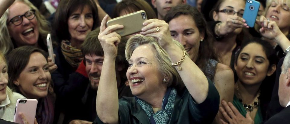 U.S. Democratic presidential candidate Hillary Clinton takes pictures with supporters at a campaign rally in Bridgeport