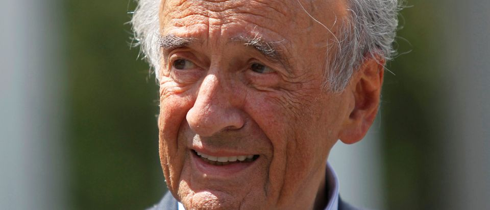 File picture of Elie Wiesel speaking to the media in Washington