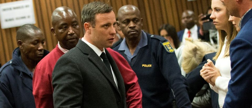 Olympic and Paralympic track star Oscar Pistorius leaves the court after his sentence hearing at the North Gauteng High Court in Pretoria