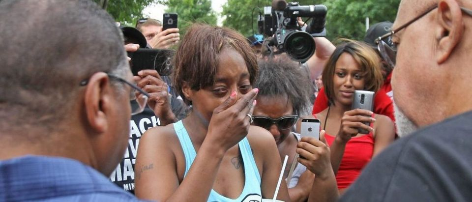 "Diamond Reynolds weeps after she recounts the incidents that led to the fatal shooting of her boyfriend Philando Castile by Minneapolis area police during a traffic stop on Wednesday, at a ""Black Lives Matter"" demonstration, in front of the Governor's Mansion in St. Paul, Minnesota, U.S., July 7, 2016. REUTERS/Eric Miller"