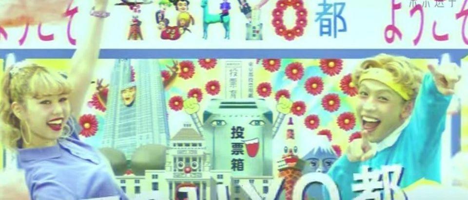 "Japanese teen models dance around ""Vote City"""