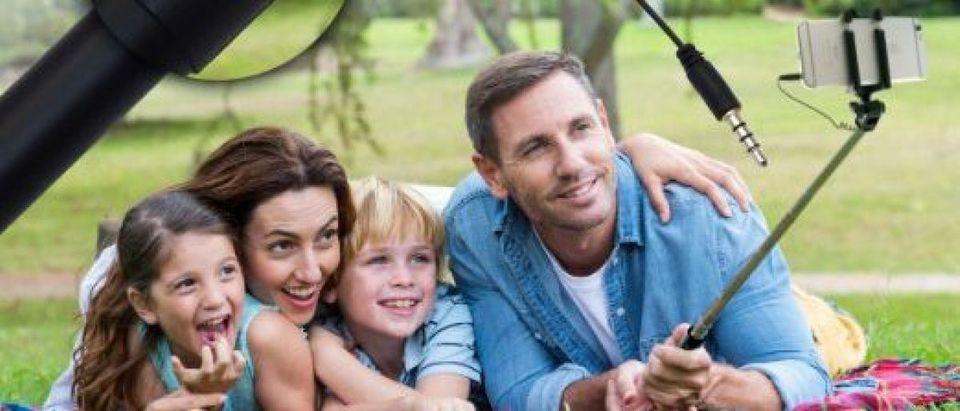 This family uses a selfie stick (Photo via Amazon)