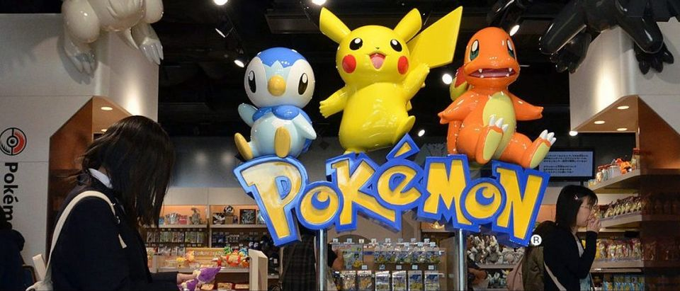 A customer looks at a stuffed Pokemon doll, a media franchise published and owned by Japanese video game company Nintendo, in Tokyo on October 24, 2012