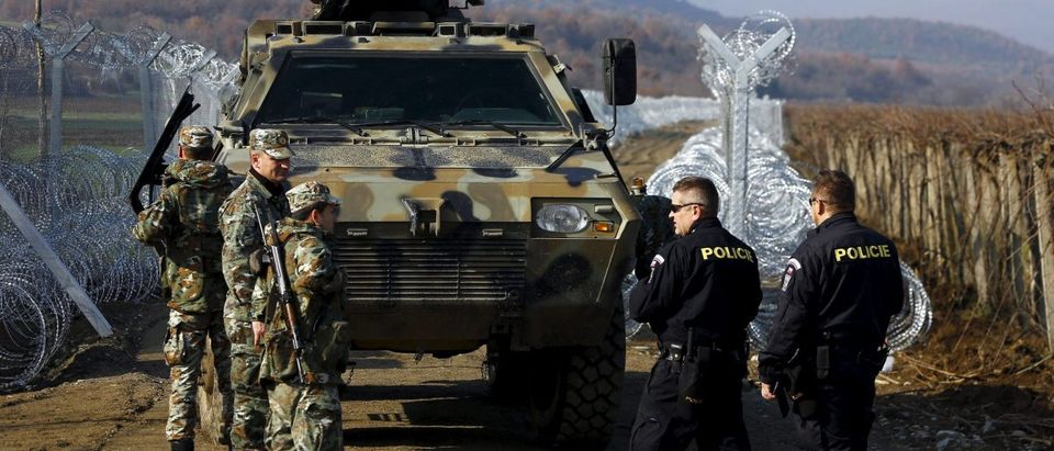 Czech police talk with Macedonian soldiers at Macedonian-Greek border near Gevgelija, Macedonia