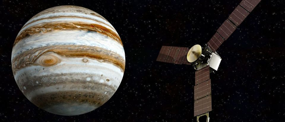 Jupiter and satellite Juno Elements of this image furnished by NASA (Shutterstock/Janez Volmajer)