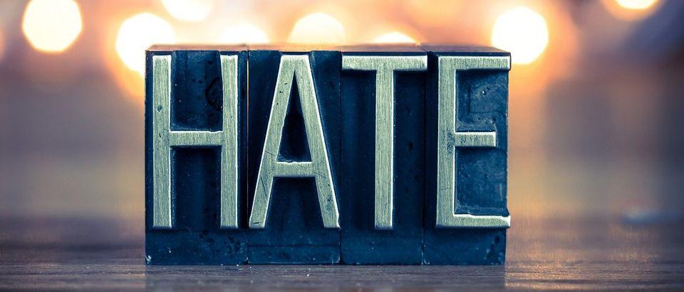 'Hate' Written Out (enterlinedesign/Shutterstock)