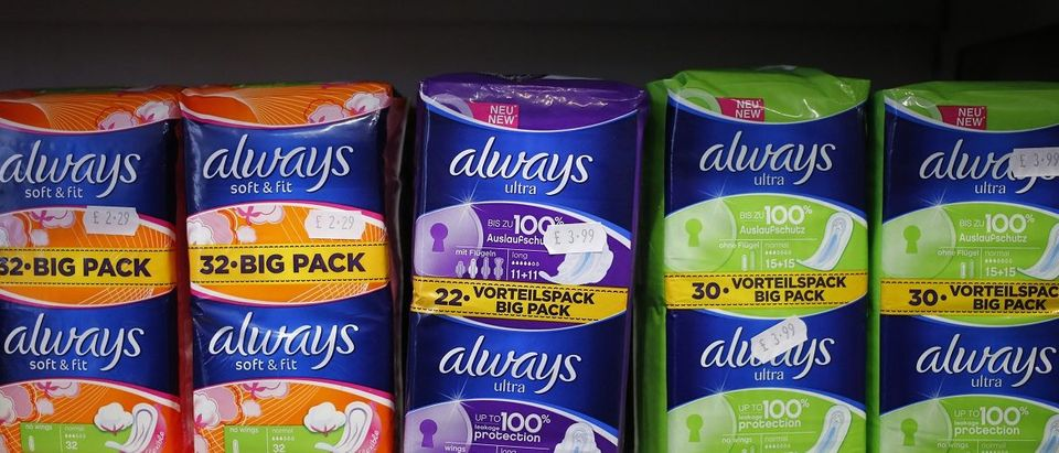 Feminine hygiene products are seen in a pharmacy in London