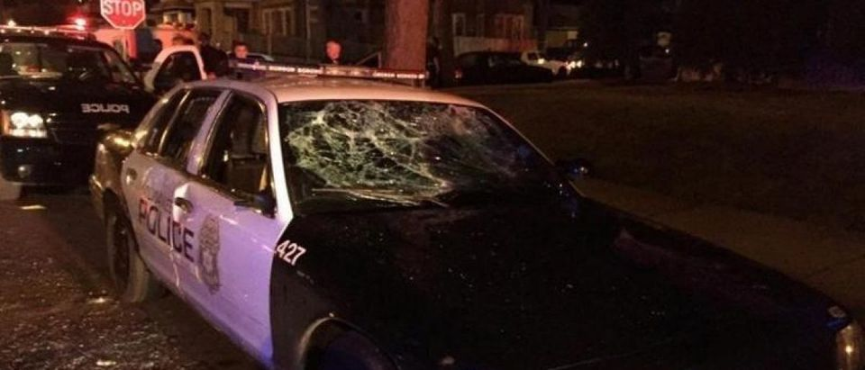 A police car with broken windows is seen in a photograph released by the Milwaukee Police Department after disturbances following the police shooting of a man in Milwaukee, Wisconsin, U.S. August 13, 2016. Milwaukee Police/Handout via REUTERS