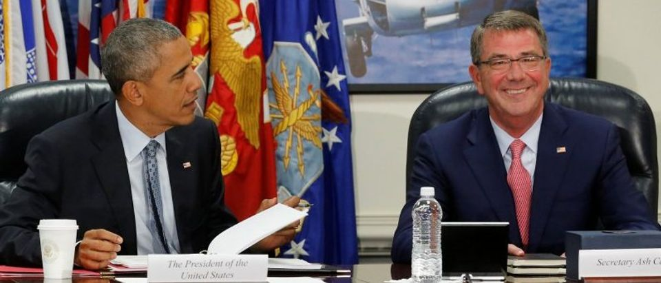 Obama and Carter sit down to a meeting of the National Security Council at the Pentagon in Arlington, Virginia, U.S.