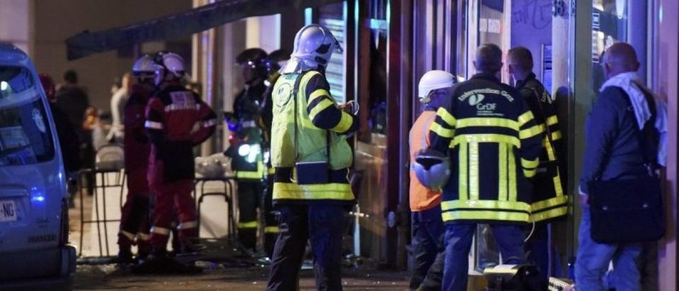 French firemen gather after a fire swept through a bar in Rouen overnight, killing 13 people and injuring six, after a birthday cake with candles and sparklers fell to the floor and set the carpet ablaze