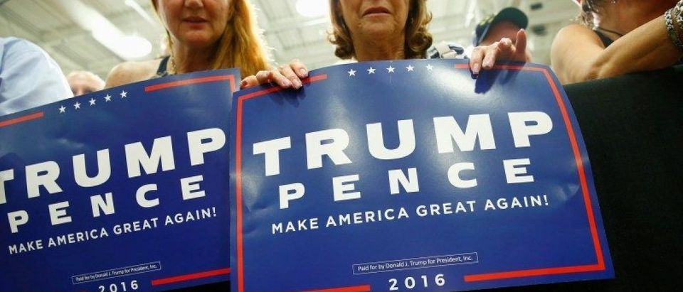 Supporters are seen as Republican U.S. presidential nominee Donald Trump attends a campaign event at Windham High School in Windham, New Hampshire