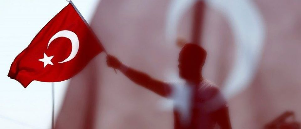 A man waves Turkey's national flag during the Democracy and Martyrs Rally in Istanbul