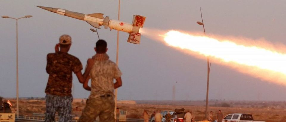 Fighters of Libyan forces allied with the U.N.-backed government fire a rocket at Islamic State fighters in Sirte