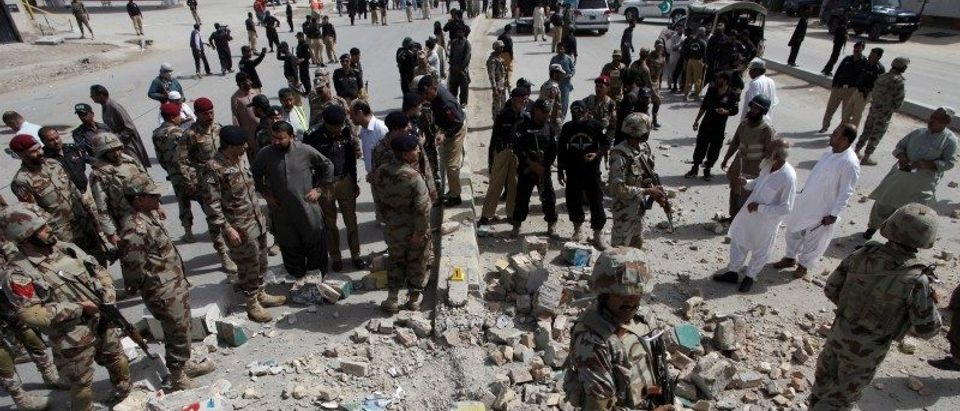 Security officials gather at the site of a bomb explosion in Quetta