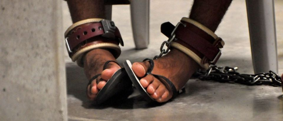 """A Guantanamo detainee's feet are shackled to the floor as he attends a """"Life Skills"""" class at Guantanamo Bay U.S. Naval Base"""