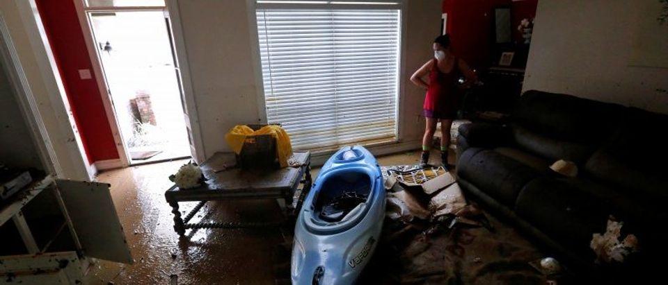 Johnette Folse stands in her flood damaged living room in Denham Springs, Louisiana, Aug. 16, 2016. (REUTERS/Jonathan Bachman)