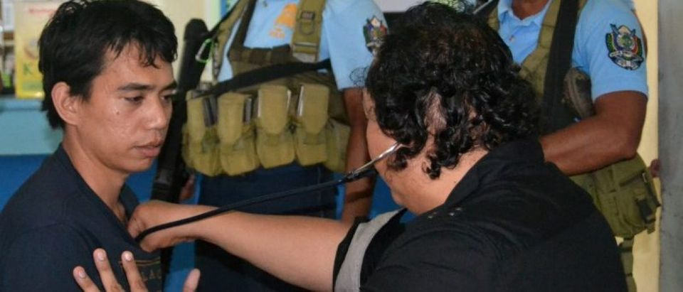 A government doctor checks Indonesian hostage Mohammad Safyan after he escaped from Abu Sayyaf captors, in Jolo