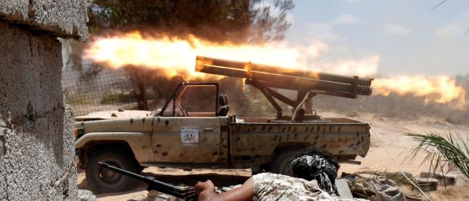 Libyan forces allied with the U.N.-backed government fire weapons during a battle with IS fighters in Sirte