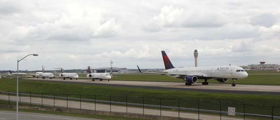 Delta airplanes line up on the taxi way for take off after Delta Air Lines' computer systems crashed on Monday, at Hartsfield Jackson Atlanta International Airport in Atlanta, Georgia