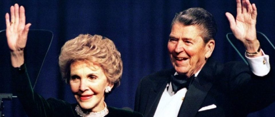 Former US President Ronald Reagan and his wife Nancy wave while attending a gala celebrating his 83rd birthday, in Washington