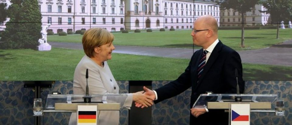 Sobotka and Merkel shake hands after a news conference in Prague