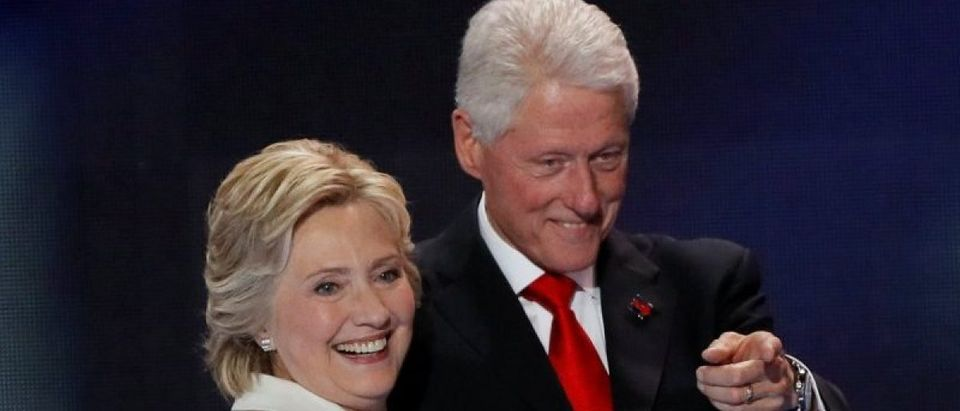 Democratic presidential nominee Hillary Clinton stands with her husband Bill Clinton after accepting the nomination on the final night of the Democratic National Convention in Philadelphia