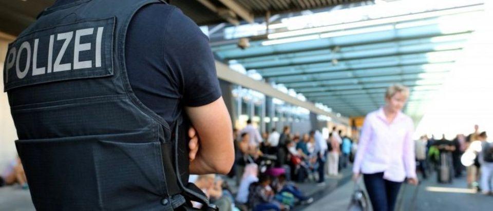 Police secures Frankfurt airport terminal after Terminal 1 departure hall was evacuated in Frankfurt