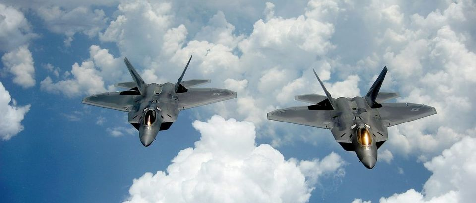 A pair of F-22 Raptors pulls away and flies behind a KC-135 Stratotanker after receiving fuel off of the East Coast on July 10, 2012. The 1st Fighter Wing at Joint Base Langley-Eustis, Va., received their first two Raptors in January 2005 and the wingÕs 27th Fighter Squadron was designated as fully operational in December 2005. The Raptors belong to the 27th FS and the KC-135 belongs to the 756th Air Refueling Squadron at Joint Base Andrews Naval Air Facility, Md. (Photo: U.S. Air Force /Master Sgt. Jeremy Lock)