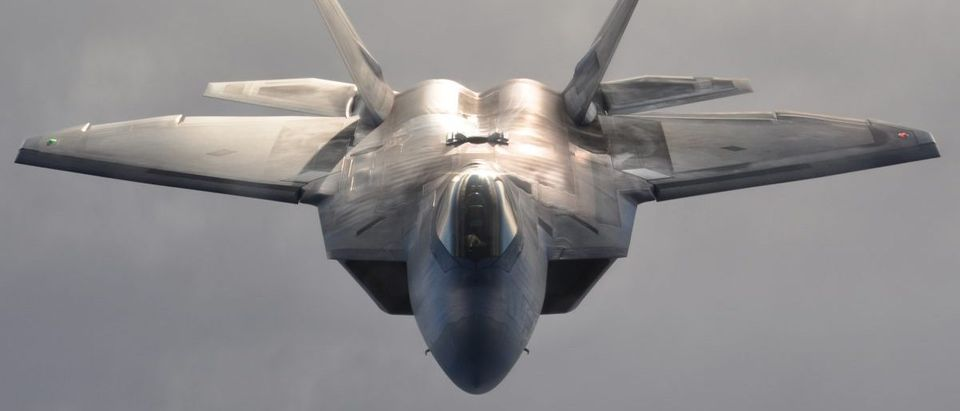 An F-22 Raptor flies over Alaska terrain after refueling Jan. 5, 2013. The F-22 is assigned to the 3rd Wing and flown by a Reserve pilot assigned to the 302nd Fighter Squadron at Elmendorf Air Force Base, Alaska. (U.S. Air Force Reserve photo/Tech. Sgt. Dana Rosso)