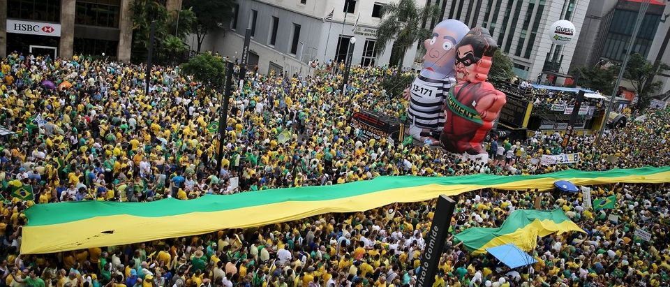 """Inflatable dolls known as """"Pixuleco"""" of Brazil's former President Luiz Lula da Silva and Brazil's President Rousseff are seen during a protest against Rousseff, part of nationwide protests calling for her impeachment, in Sao Paulo"""