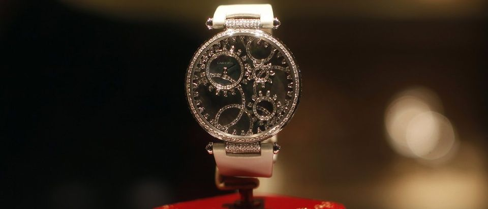 A diamond Cartier watch is seen in a display in a shop on 5th Avenue in New York City