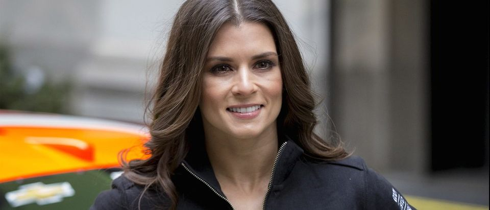 NASCAR racer Danica Patrick poses for photographers outside the New York Stock Exchange during web hosting company GoDaddy's initial public offering April 1, 2015