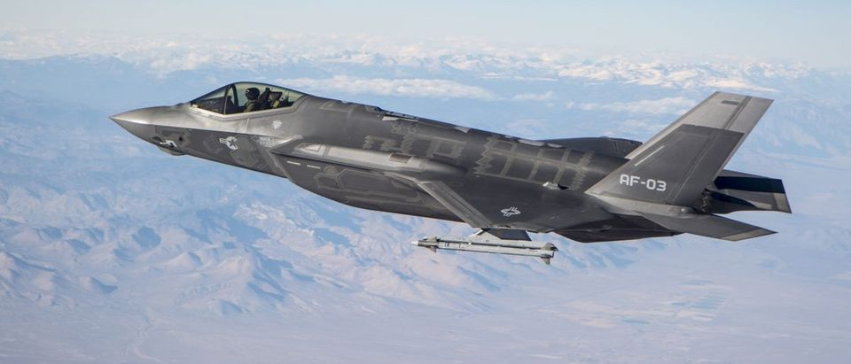An F-35A Conducts Testing With An AIM-9X over the skies of Calif..