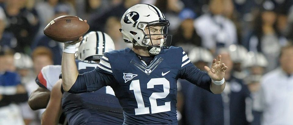 Quarterback Tanner Mangum of the Brigham Young Cougars throws a pass during their game against the Connecticut Huskies at LaVell Edwards Stadium on October 2, 2015