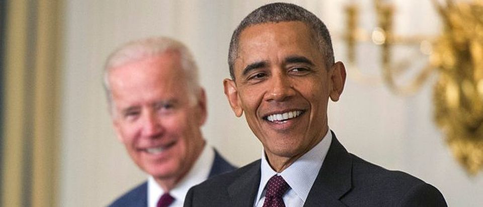 President Barack Obama, joined by Vice President Joe Biden, share a laugh (Getty Images)